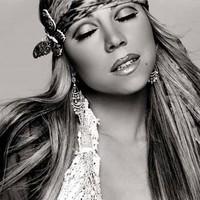 Mariah Carey bate a Elvis